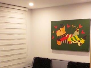 Una sala de estar llena de muebles y una pintura en Horizontes de la Católica