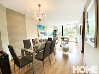 Una sala de estar llena de muebles y una lámpara de araña en Apartamento en venta en Santa Bárbara Central, de 55,8mtrs2
