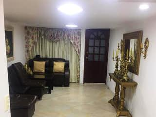Una sala de estar llena de muebles y una chimenea en VILLAS DEL PRADO