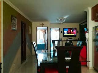 Una sala de estar llena de muebles y una televisión de pantalla plana en Apartamento en venta en Belén Centro, de 52mtrs2