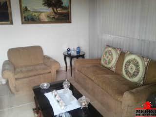 Una sala de estar llena de muebles y un sofá en EDIFICIO ARIES