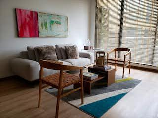 Una sala de estar llena de muebles y una mesa en Apartamento en venta en Cajica, 67mt con balcon