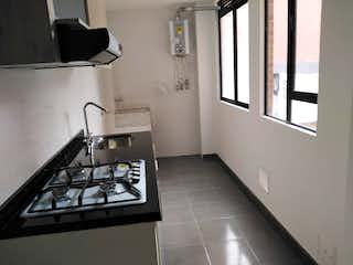 Una cocina con una estufa y un fregadero en Apartamento en venta en Villemar, de 30mtrs2