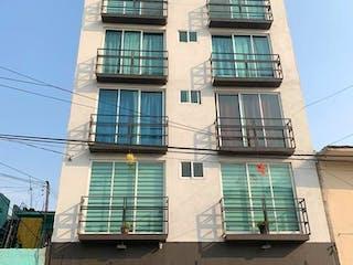 Un gran edificio con un reloj en él en Depto 56 mts + Roof Garden GAM Vallejo