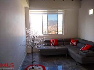 Una sala de estar llena de muebles y una ventana en Meseta San Diego