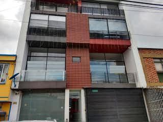 Un edificio de ladrillo rojo con un edificio de ladrillo rojo en Edificio