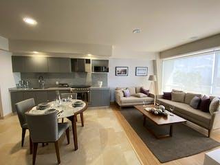 Una sala de estar llena de muebles y una mesa en La Cité Santa Fe