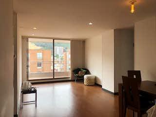 Una sala de estar llena de muebles y una televisión de pantalla plana en Conjunto Altos Del Moral