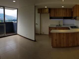 Una cocina con una estufa de fregadero y armarios en URB SIERRA MORENA