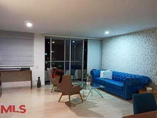 Una sala de estar llena de muebles y una televisión de pantalla plana en Rivera de Suramérica