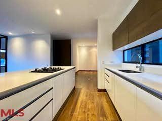 Una cocina que tiene un fregadero y una estufa en Q Concept (San Lucas)