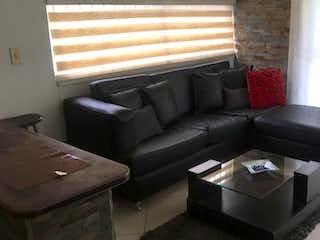 Una sala de estar llena de muebles y una ventana en Apartamento en venta en Las Palmas de dos habitaciones