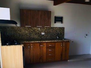 Una cocina con armarios de madera y un fregadero en Apartamento en venta en El Salado de dos habitaciones