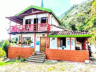 Un pequeño edificio con un banco en él en Casa en venta en Sector Haceb 600m² con Bbq...