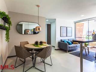 Una sala de estar llena de muebles y una planta en maceta en Sabatto