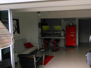 Una sala de estar llena de muebles y una televisión de pantalla plana en Venta Apartamento Santafe de Antioquia