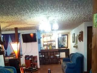 Una sala de estar llena de muebles y una ventana en Casa en venta en El Porvenir, de 104mtrs2