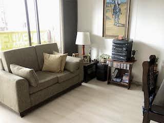 Una sala de estar llena de muebles y una ventana en Apartamento En Venta En Bogota Ciudad Salitre