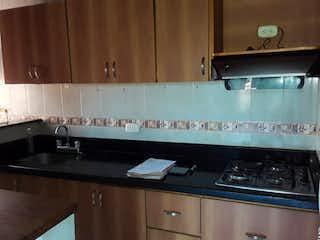 Una cocina con una estufa y un fregadero en  MIRADOR DE SAN MATEO