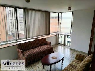 Una sala de estar llena de muebles y una ventana en EDIFICIO CASA BLANCA