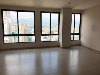 Una vista de una habitación con un gran ventanal en Departamento en venta de 120 m2 en Bosque Real con 2 recámaras