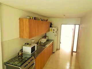 Una cocina con una estufa y un fregadero en Venta de casa en Itagui