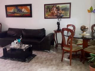 Una sala de estar llena de muebles y una pintura en Apartamento en venta en El Dorado de tres alcobas