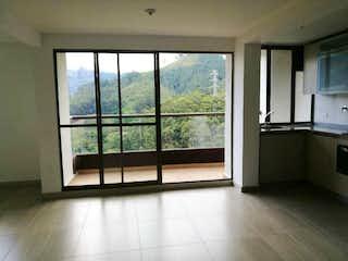 Una vista de una cocina con un gran ventanal en VENDOAPARTAMENTOSABANETAPANDEAZUCAR