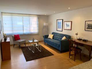 Una sala de estar llena de muebles y una televisión de pantalla plana en VENDO: APARTAMENTO: CHAPINERO: 56m2:2H