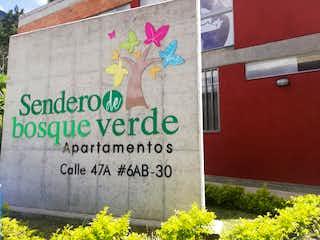 Una señal que está en el lado de un edificio en Apartamento en Venta BUENOS AIRES