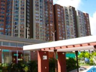Una señal de calle delante de un edificio en Apartamento en Venta BUENOS AIRES