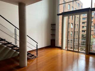 Una vista de una habitación con una puerta de cristal en Apartamento En Arriendo/venta En Bogota Chico Reservado