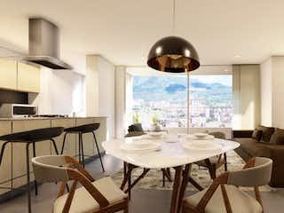 Una sala de estar llena de muebles y una ventana en Apartamento en venta en Barrio Laureles de tres habitaciones