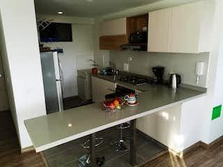 Una cocina con nevera y fregadero en Apartamento en venta en Santa María del Lago, de 60mtrs2