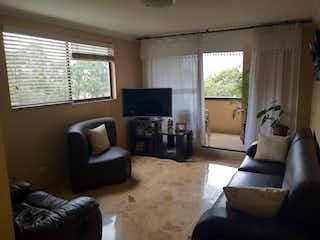Una sala de estar llena de muebles y una televisión de pantalla plana en Palma Real
