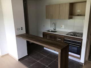 Una cocina con un fregadero y una estufa en Apartamento en venta en La Aldea, de 88mtrs2