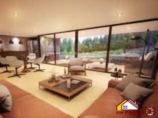 Una sala de estar llena de muebles y una mesa en CLUB TERRA