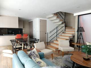 Una sala de estar llena de muebles y una televisión de pantalla plana en Departamento en venta en Anahuac de 146mts