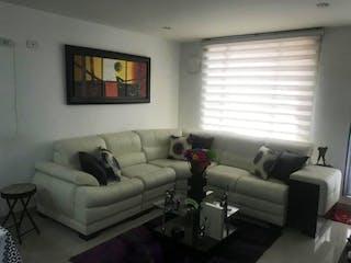 Una sala de estar llena de muebles y una ventana en VENTA APARTAMENTO SAN JOAQUIN