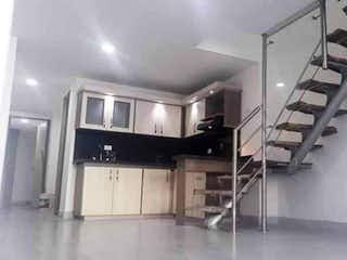 Una habitación llena de un montón de armarios de madera en Apartamento en venta en Barrio Obrero, de 108mtrs2