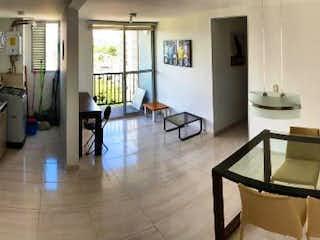 Una sala de estar llena de muebles y un suelo de madera en Apartamento en venta en Fontibón, 56mt con balcon