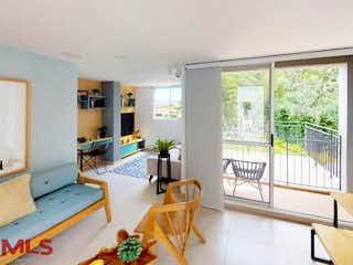Una sala de estar llena de muebles y una ventana en Riovivo