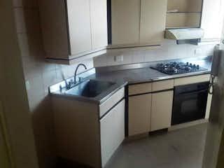 Una cocina con una estufa de fregadero y microondas en Apartamento en venta en La Castellana, de 115mtrs2