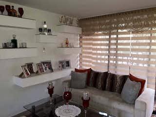 Una sala de estar llena de muebles y una chimenea en Apartamento en venta en Barrio Buenos Aires, de 70mtrs2