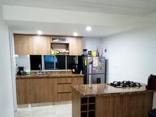 Una cocina con un gran horno encimera en Vendo apartamento remodelado 94 Mts Pilarica