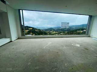 Una vista de una ciudad desde una ventana en Casa en venta en La Calera, 380mt de dos niveles