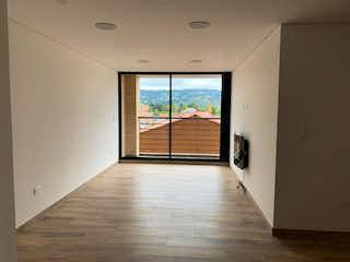Una vista de una sala de estar desde un pasillo en Apartamento en Venta Bojacá