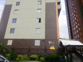 Un edificio alto con una señal en él en Apartamento en venta en El Chagualo 40m² con Gimnasio...