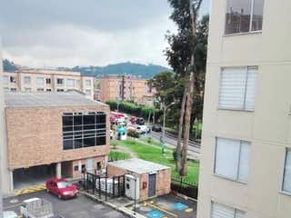 Una calle de la ciudad llena de tráfico y edificios en Apartamento en Venta LA CAMPIÑA