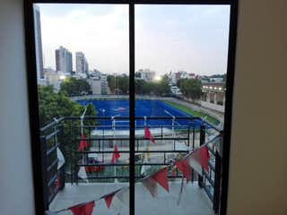 Una vista del horizonte de la ciudad desde una ventana en DEPARTAMENTO EN VENTA ENMARCA DEL VALLE